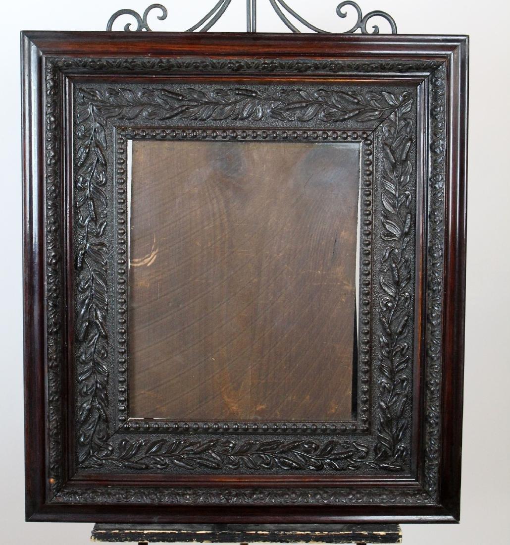 Foliate carved oak frame