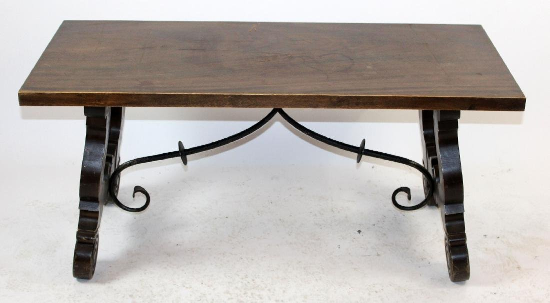 Spanish coffee table with iron stretcher