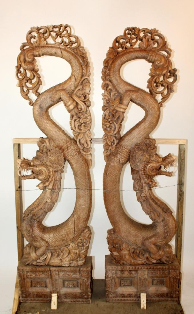 Pair of Chinese heavily carved teak temple dragon