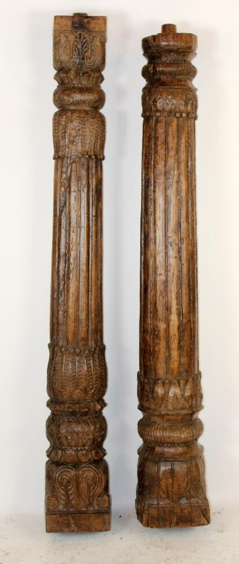 Companion lot of 2 carved wooden columns