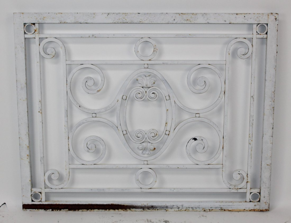 White painted scrolled iron panel