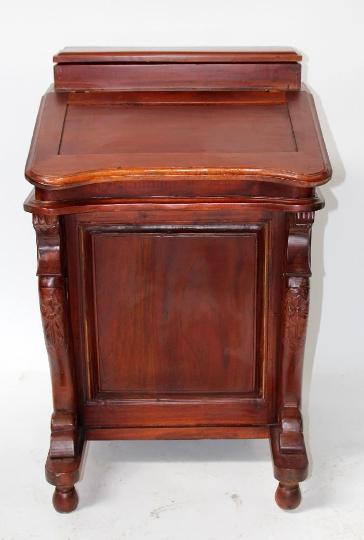 Mahogany slant front davenport desk