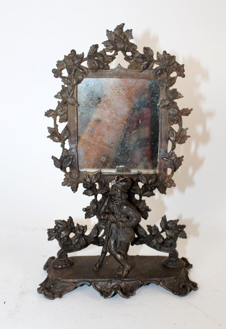 Miniature black forest carved vanity mirror