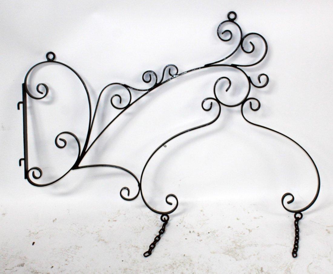 Scrolled iron sign bracket