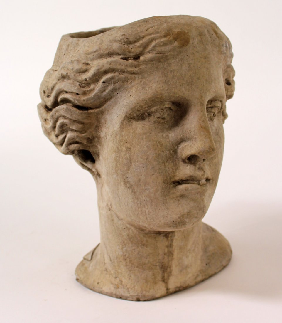 Cast concrete female bust planter