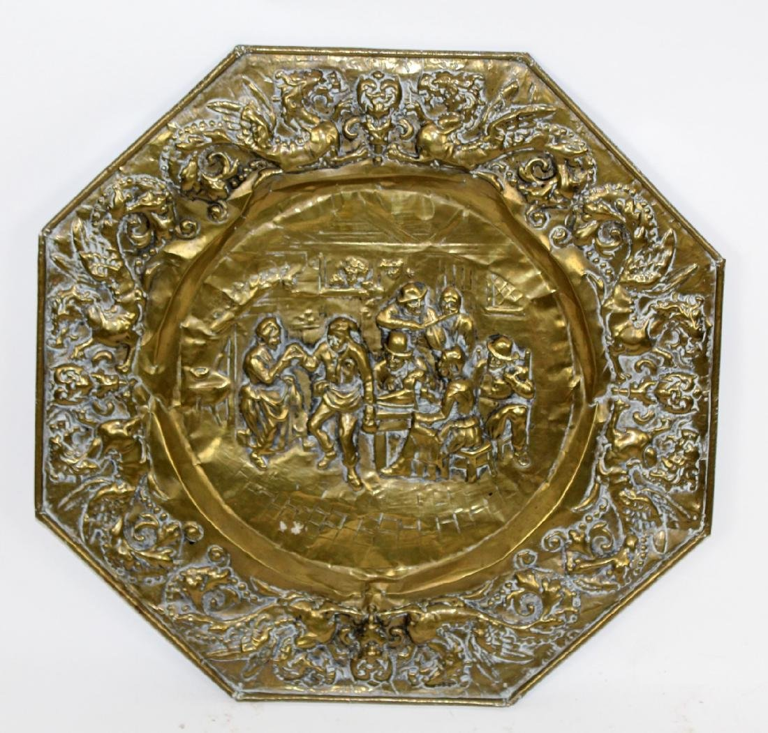 Embossed brass charger