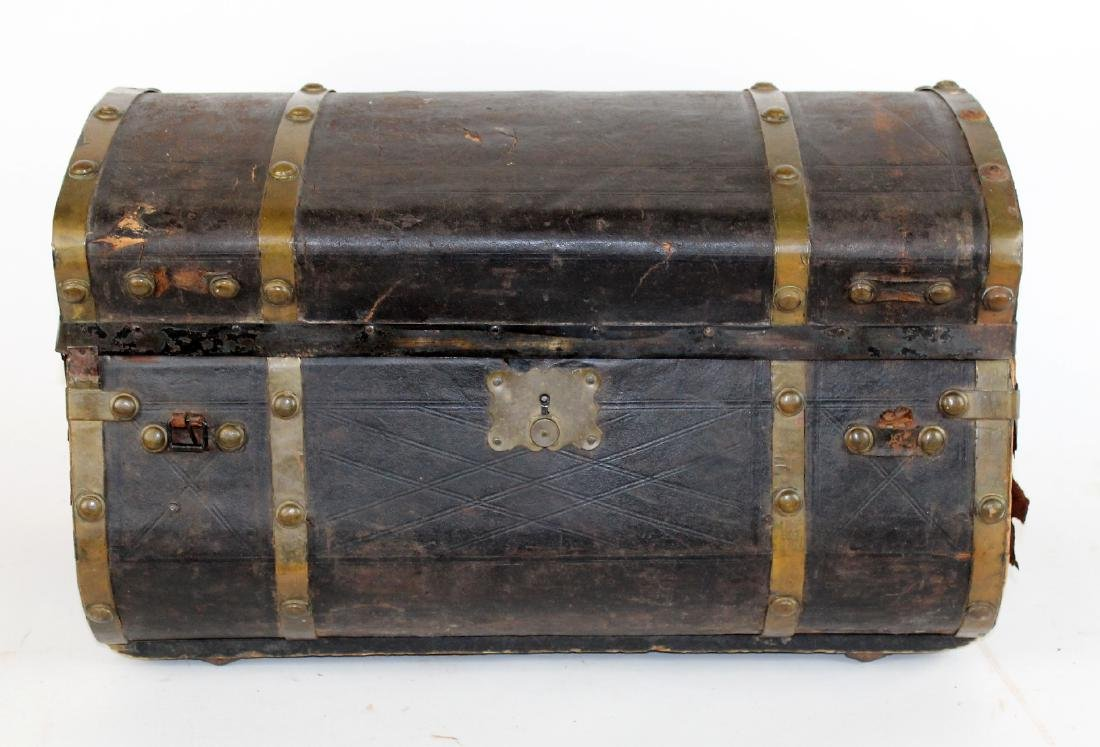 Antique leather dome top traveling trunk