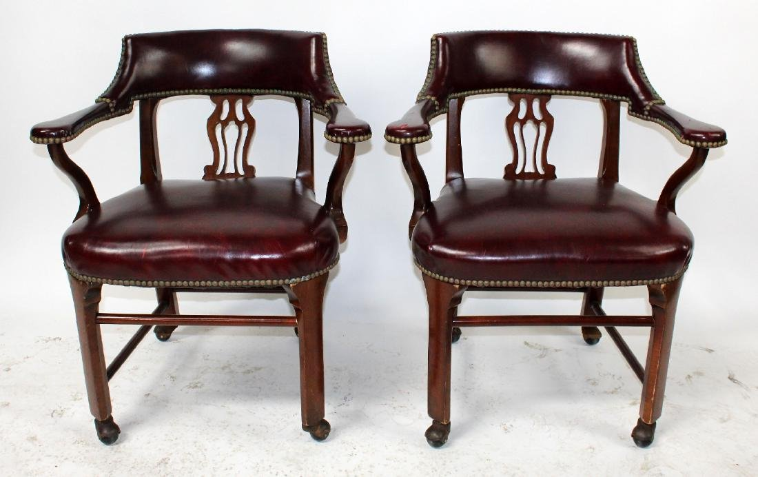Pair of vintage red leather armchairs