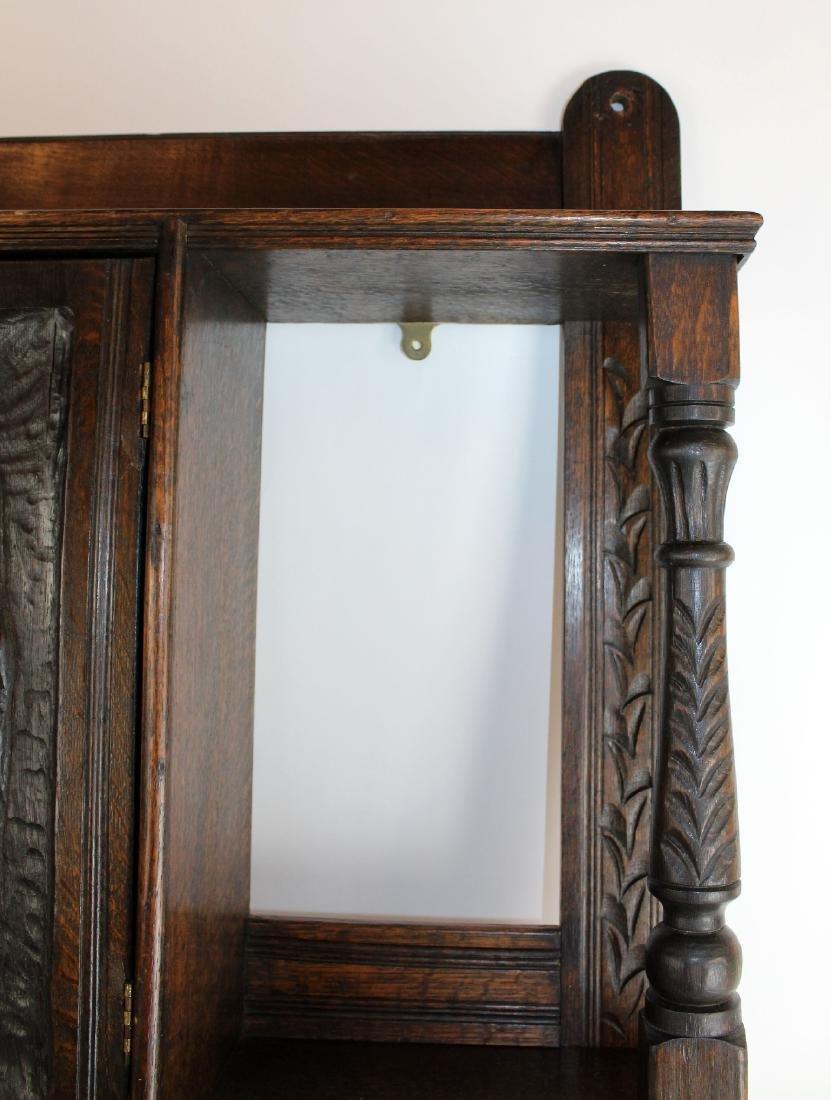 Carved figural wall shelf in oak - 3