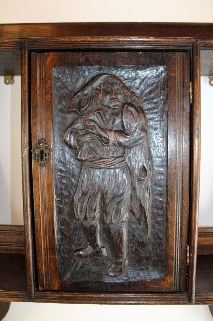 Carved figural wall shelf in oak - 4