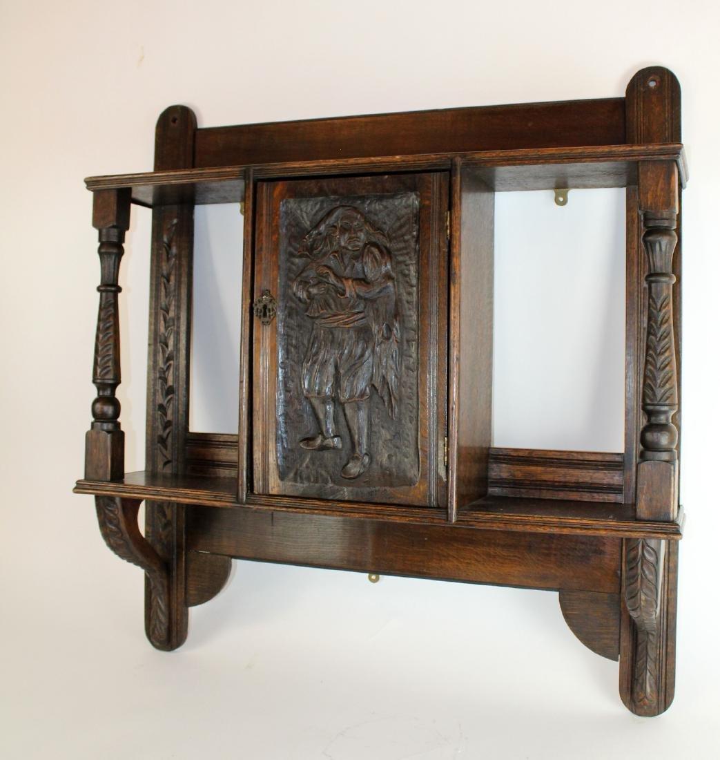 Carved figural wall shelf in oak - 5