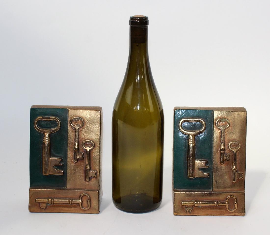 Vintage bronze clad bookends with keys