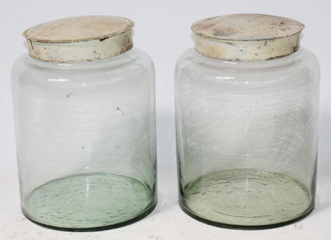 Pair of antique glass apothecary jar with metal lids