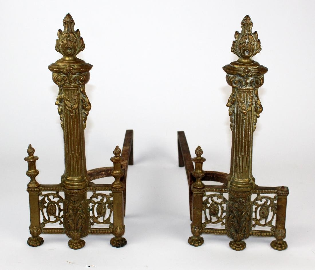 Pair of bronze andirons with torch and quiver