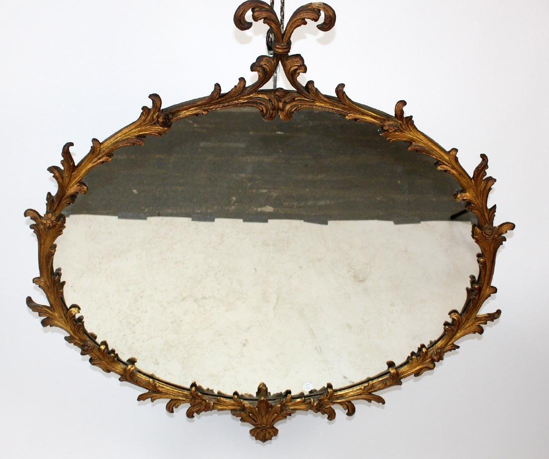 Oval gilt wood mirror with acanthus decoration