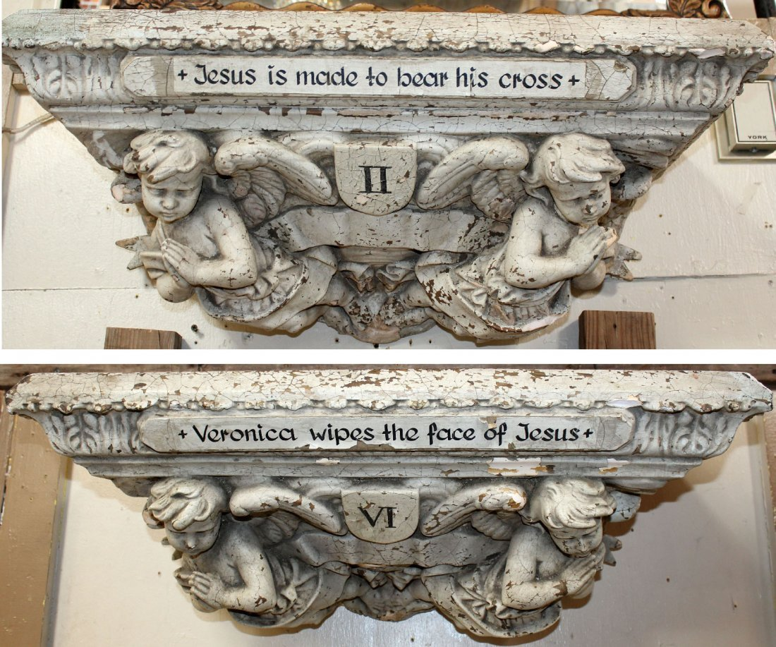 Pair of plaster corbels with cherubs from a church