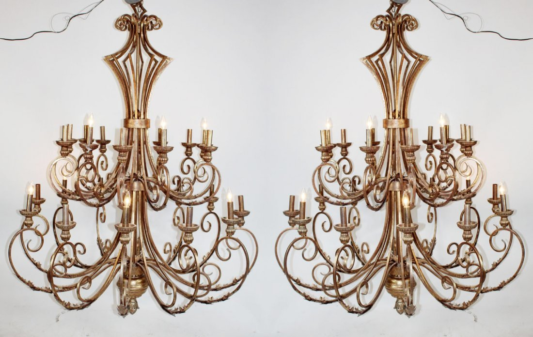 Pair of grand scale iron chandeliers