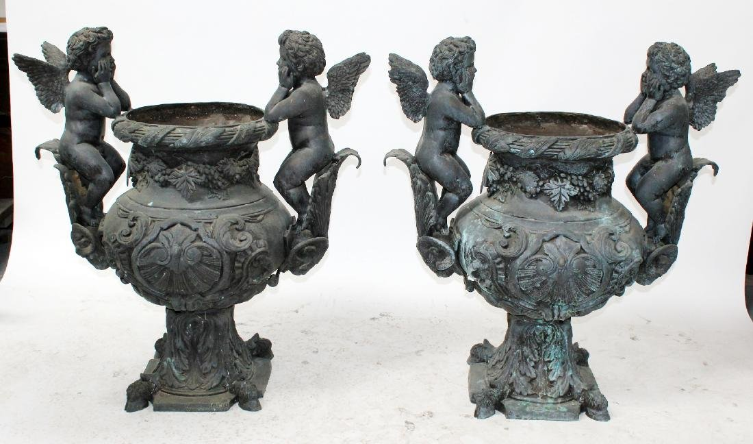 Pair of classical bronze urns with cherubs