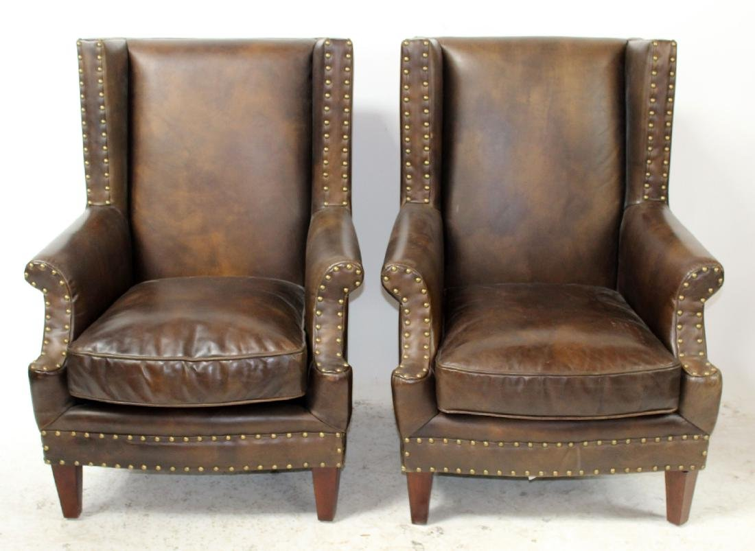 Pair of leather armchairs with nailhead trim