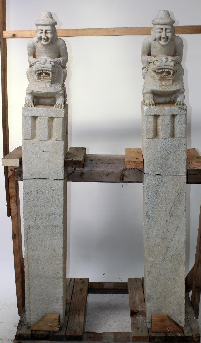 Pair of carved stone Chinese temple pillars