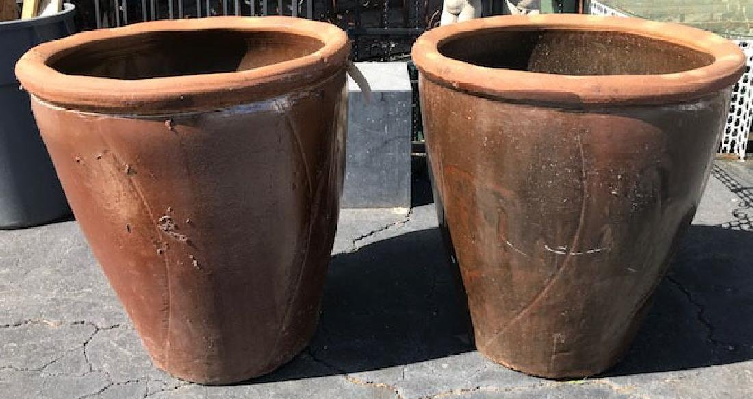 Pair of large glazed terra cotta urns