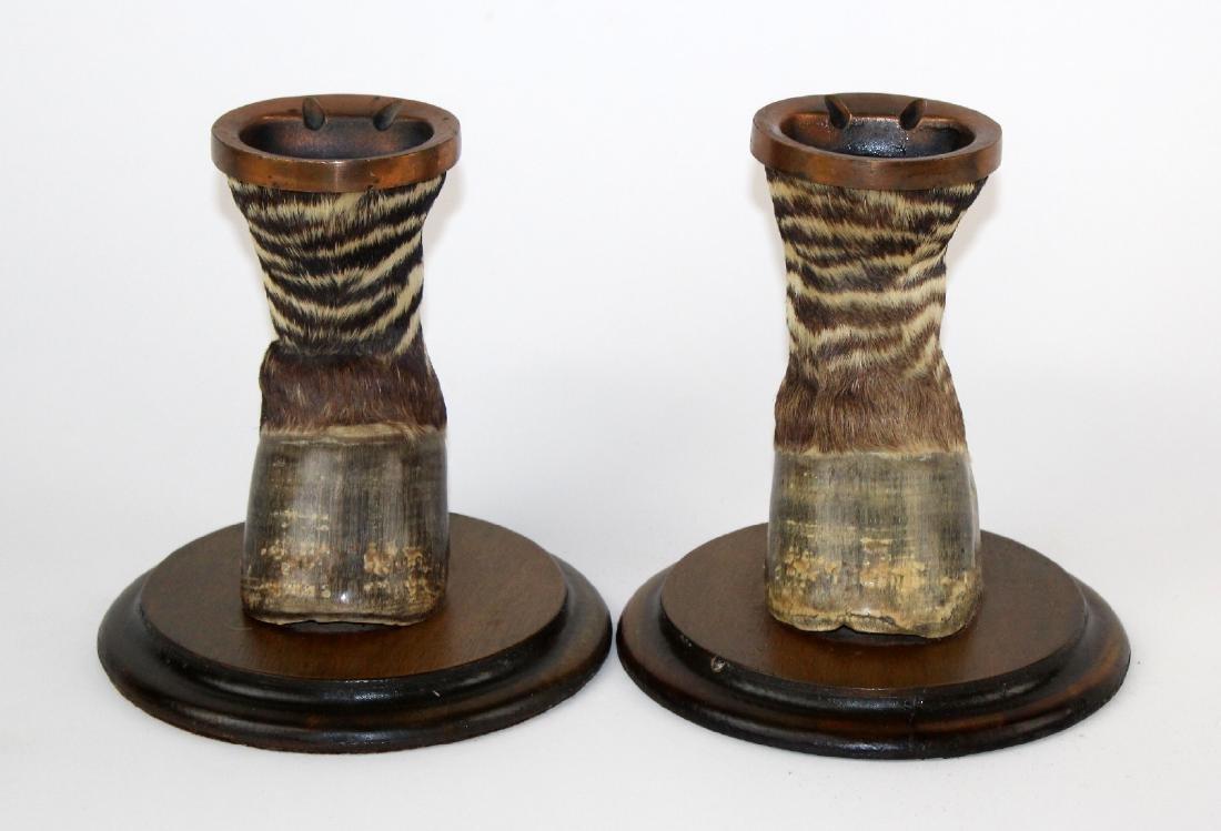 Pair of vintage Zebra hoof ashtrays on wooden bases