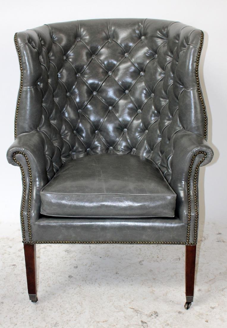 Chesterfield style grey vinyl tufted armchair