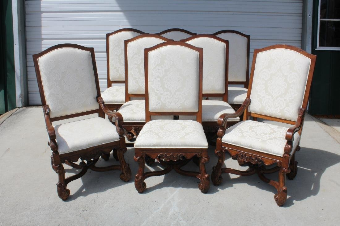 8 carved mahogany dining chairs with ivory damask