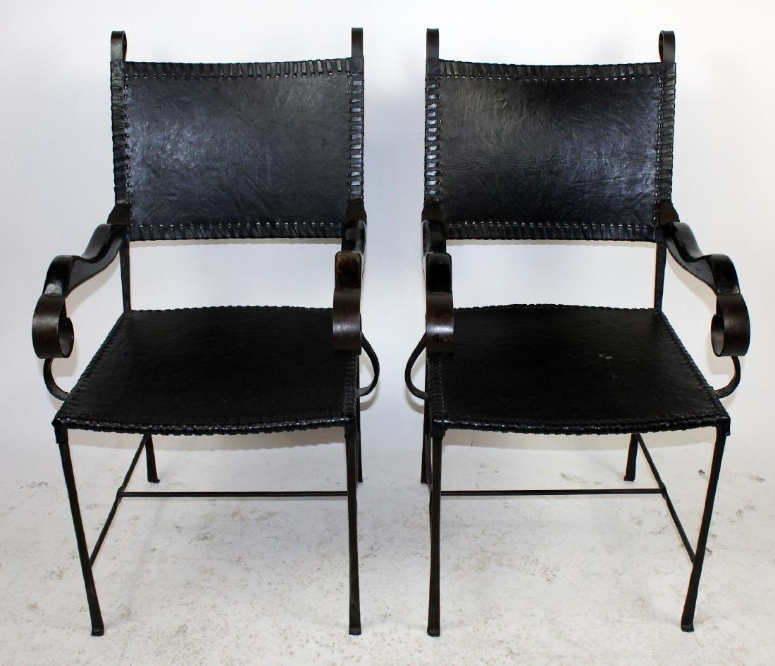 Pair of leather and iron armchairs