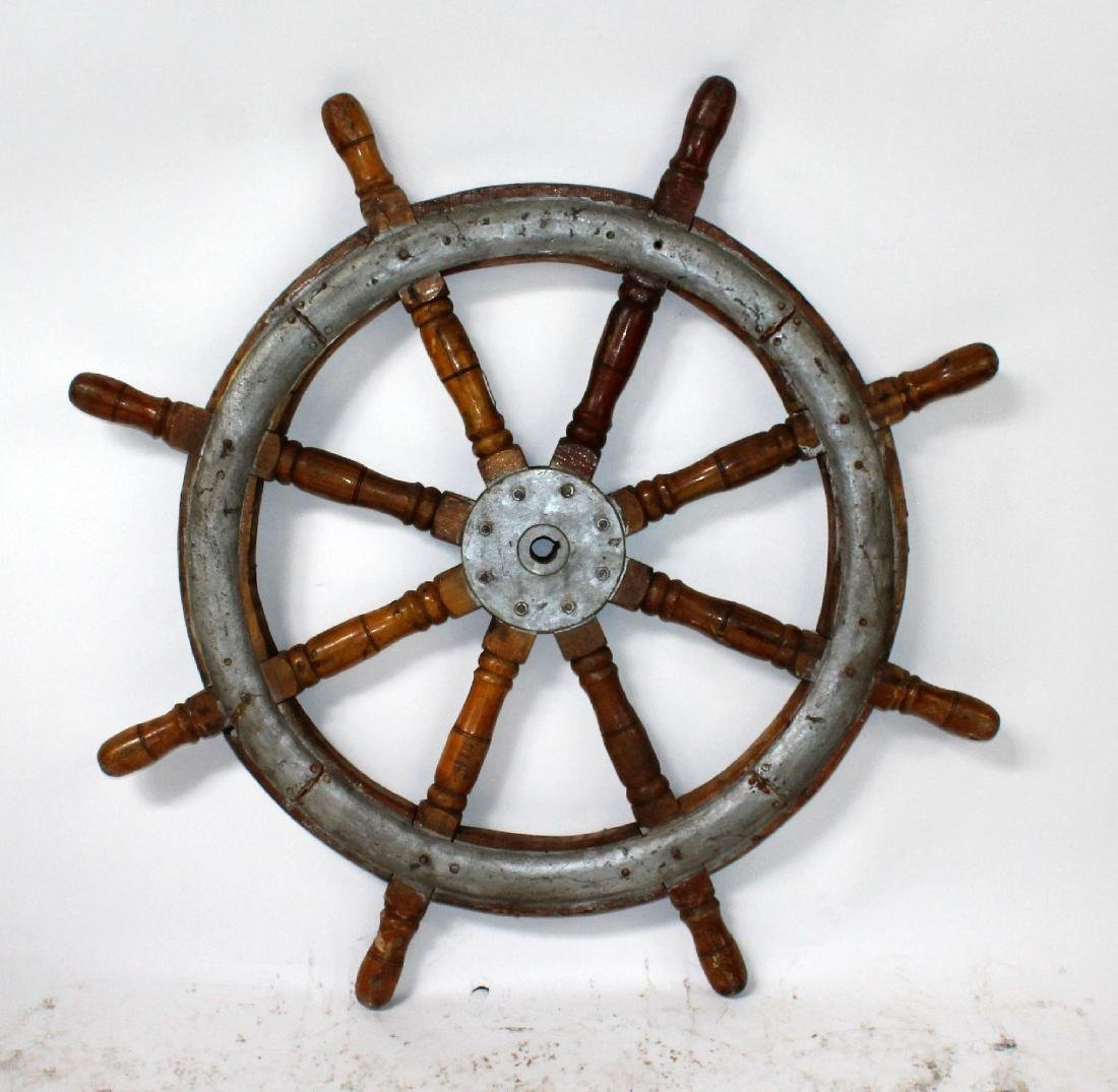 Vintage wooden ships wheel with iron