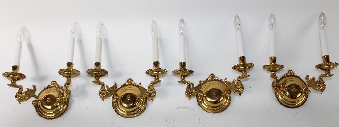 Set of 4 brass Empire style double arm wall sconces