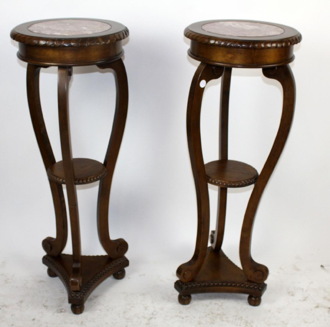 Pair of tiered mahogany pedestals