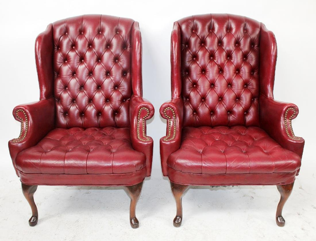 Pair of Chesterfield style leather wing back chairs