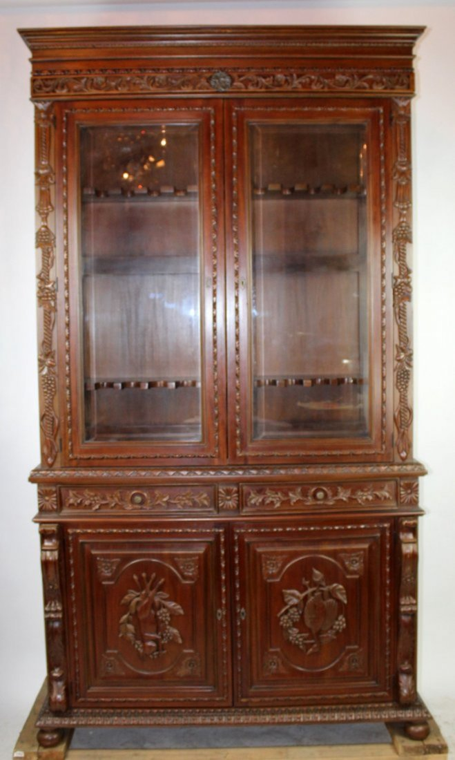 Louis XIII style carved mahogany gun cabinet