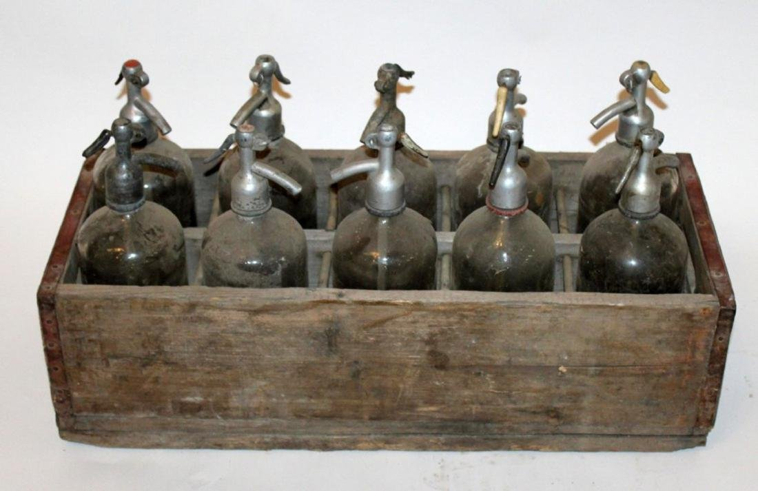 Antique wooden crate with seltzer bottles