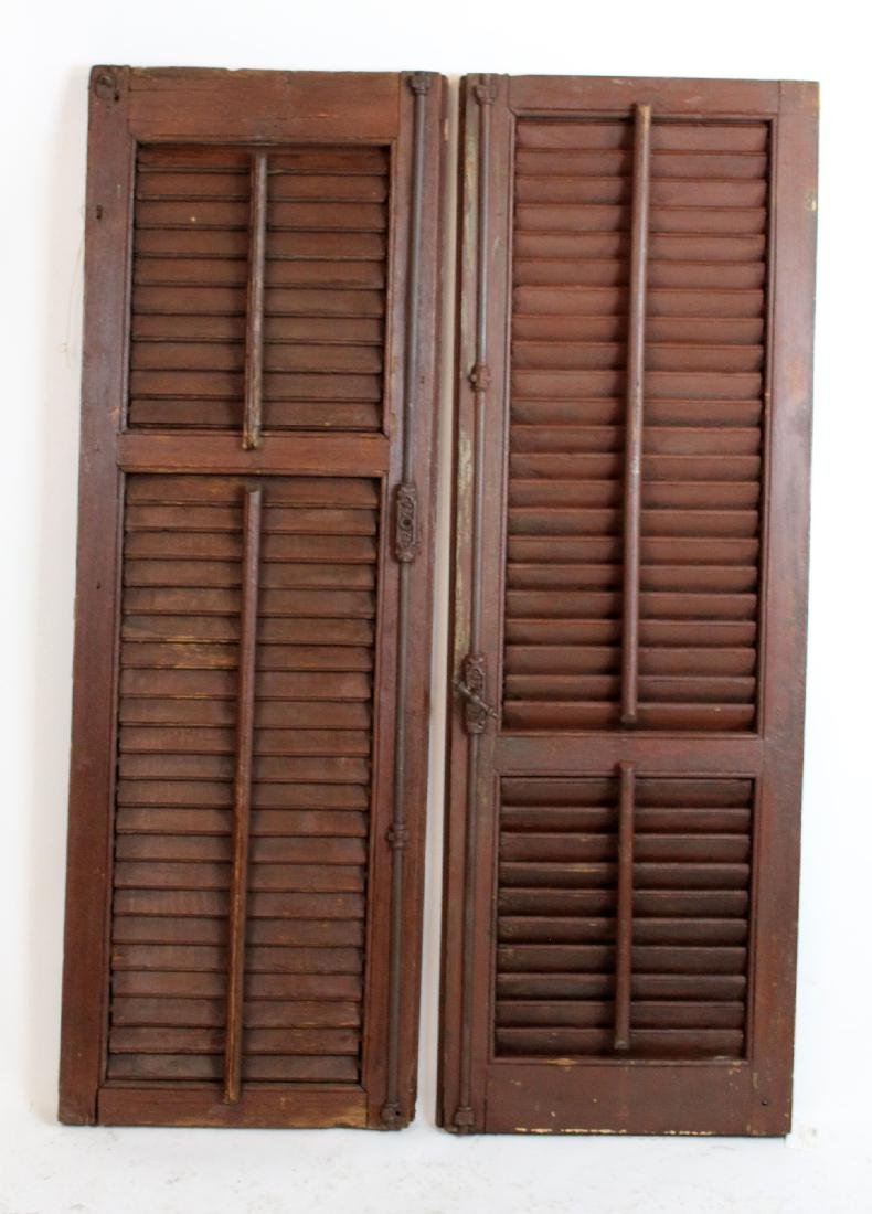 Pair of painted brown shutters