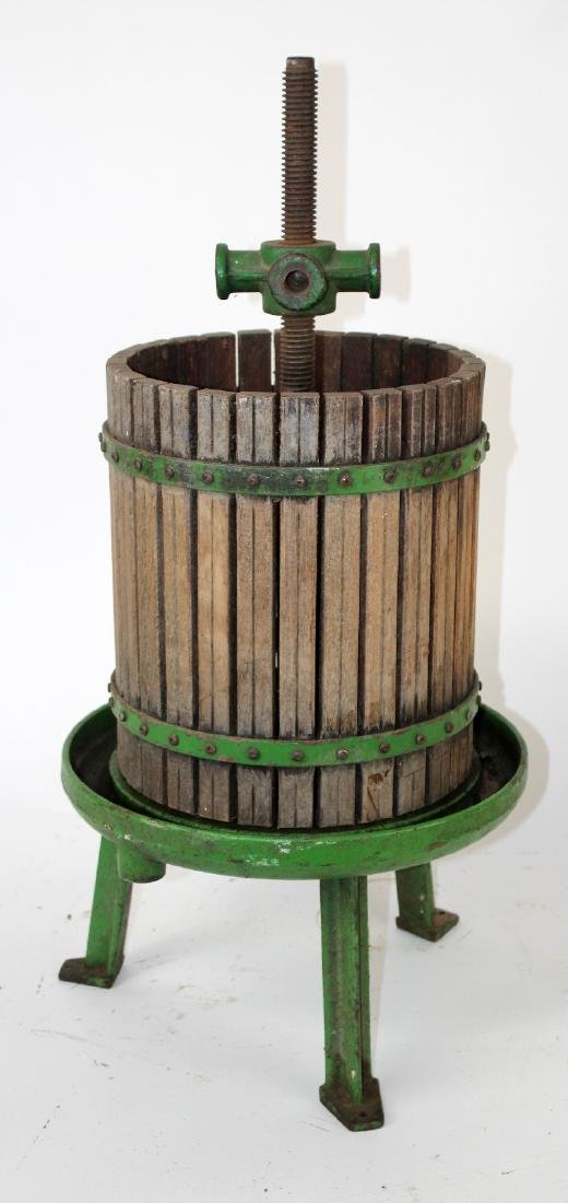 Vintage painted cast iron wine press
