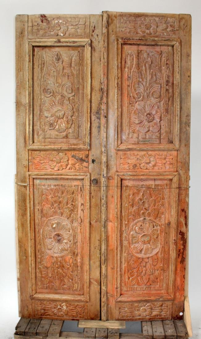 Pair of floral relief carved pine doors