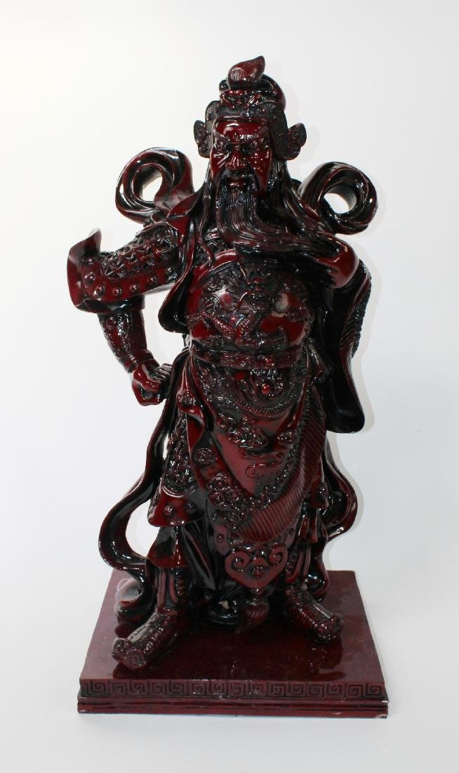 Red lacquered Chinese warrior statue