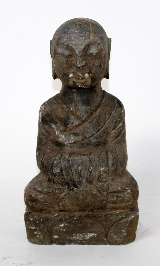 Small carved stone seated Buddha