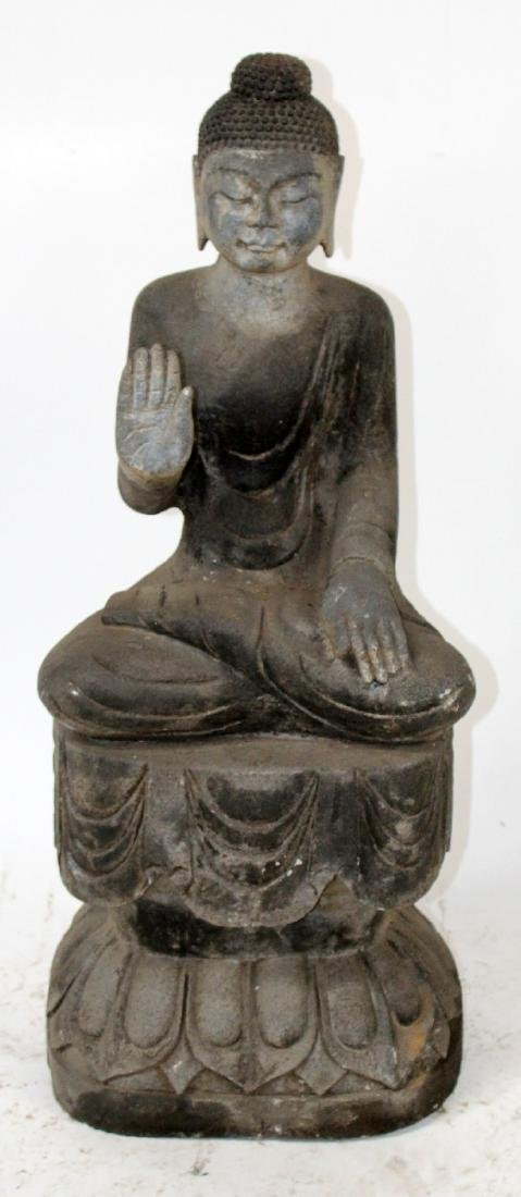 Carved stone Buddha seated on lotus base