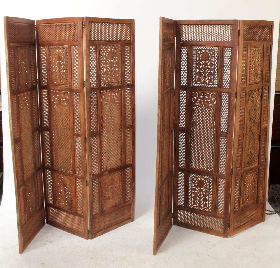Pair of pierce carved teak folding screens