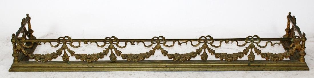 Louis XVI gilt bronze fireplace fender