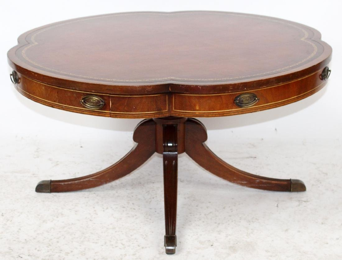 Mahogany clover shaped leather top coffee table