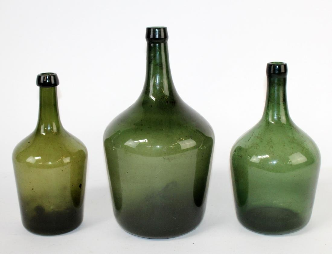 3 green glass demijohn wine bottles