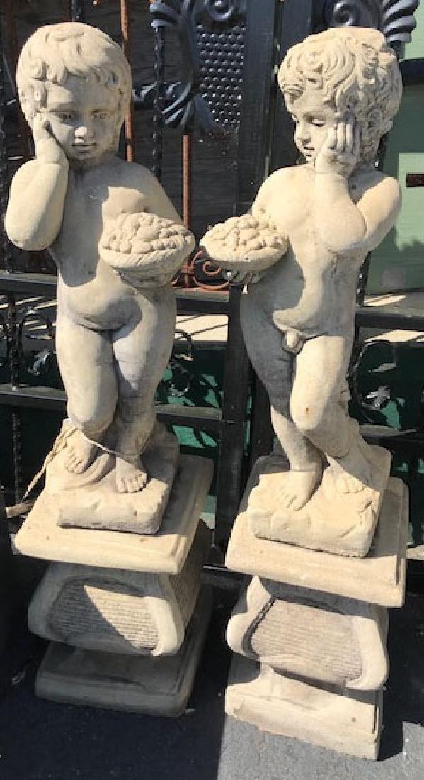 Pair of cast concrete cherubs on pedestals