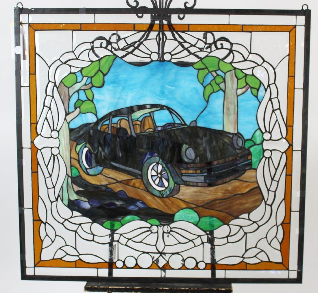 Stained and leaded glass window with car