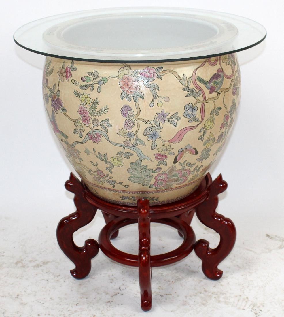 Chinese porcelain fish bowl on wooden stand