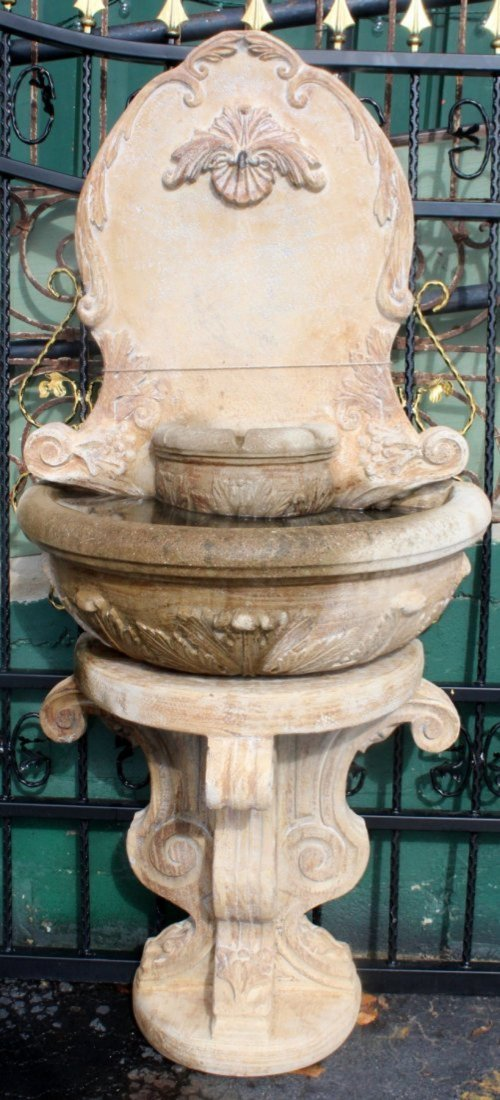 Cast stone wall fountain
