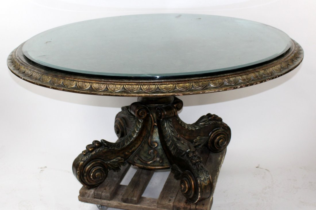 Carved wood center table with faux marble finish
